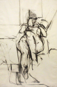 This charcoal drawing depicts a nude woman lying down on her back within a minimally described space. Her left leg and elbow are both bent, adding intrigue and dynamism to her form. Sweeping, gestural lines and soft smudges of charcoal create exciting contrasts in value and mark making. Foreshortening is also used to create depth in the work, with the body of the nude woman appearing to recede into the background.