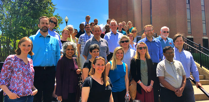 Smiling fellows and staff from June 2017 assembled on the staps of the W.E.B Du Bois Library