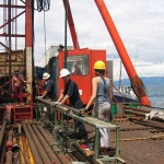 The deck on the Lake Malawi Drilling Barge. Working on drill pipe which was typically covered in water and grease - it was slippery...