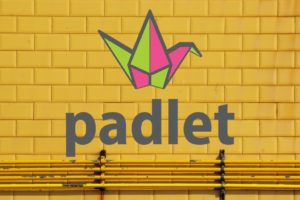 Brick Wall with padlet logo on it
