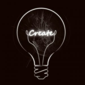 "light bulb outline with the word ""create"" inside"