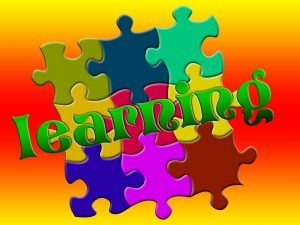 colorful puzzle pieces with the word learning.