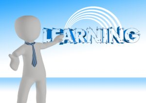 person pointing to the word learning