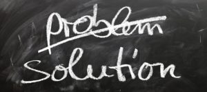 """Problem"" and ""solution"" written on a blackboard. ""Problem"" is crossed out"