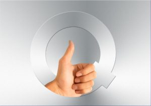 """""""Q"""" quality up-thumb"""